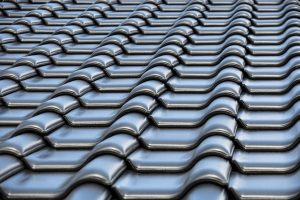 Read more about the article The Pros and Cons of Re-Roofing vs. Roof Replacement
