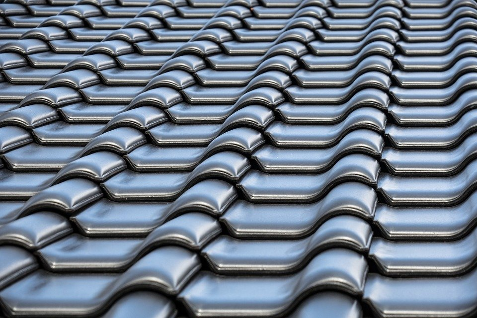 The Pros and Cons of Re-Roofing vs. Roof Replacement